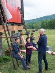 "Actress Frances McDormand, left, actor Peter Dinklage and director/writer Martin McDonagh on the set of ""Three Billboards Outside Ebbing, Missouri."""