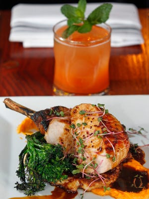 At The Original, 2498 N. Bartlett Ave., a pork chop from the Duroc heritage breed is served with sweet potato puree, cider mustard demi-glace, broccolini and a sauerkraut pancake. With it, the menu suggests A Globe Made of Rock cocktail: rum and carrot, ginger and lime juices.