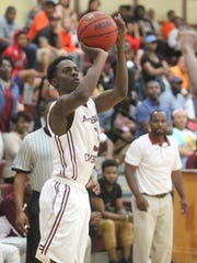 Madison County's Chris Simmons drills a 3-pointer during a Region 3-1A final win against Hawthorne.