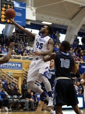 Seton Hall forward Stephane Manga drives to the basket against Maine guard Shaun Lawton in Saturday's game.