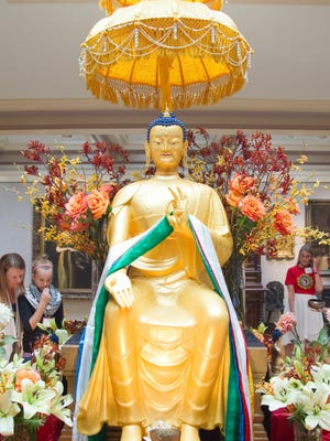 The Maitreya Buddha, an incarnation of the future, is seen in a 2012 show in Des Moines.