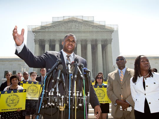 Ryan P. Haygood, director of the NAACP Legal Defense Fund, talks outside the Supreme Court in on June 25, 2013, about the Shelby County v. Holder voting rights case.
