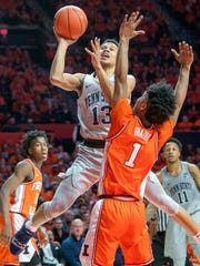 Penn State guard Rasir Bolton (13) shoots over Illinois guard Trent Frazier (1) during the second half of an NCAA college basketball game in Champaign, Ill., Saturday, Feb. 23, 2019.(AP Photo/Robin Scholz)