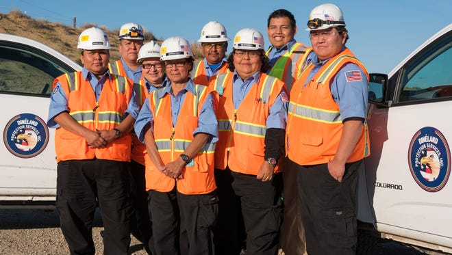 Dinéland Protection Service employees stand together for a group photo..