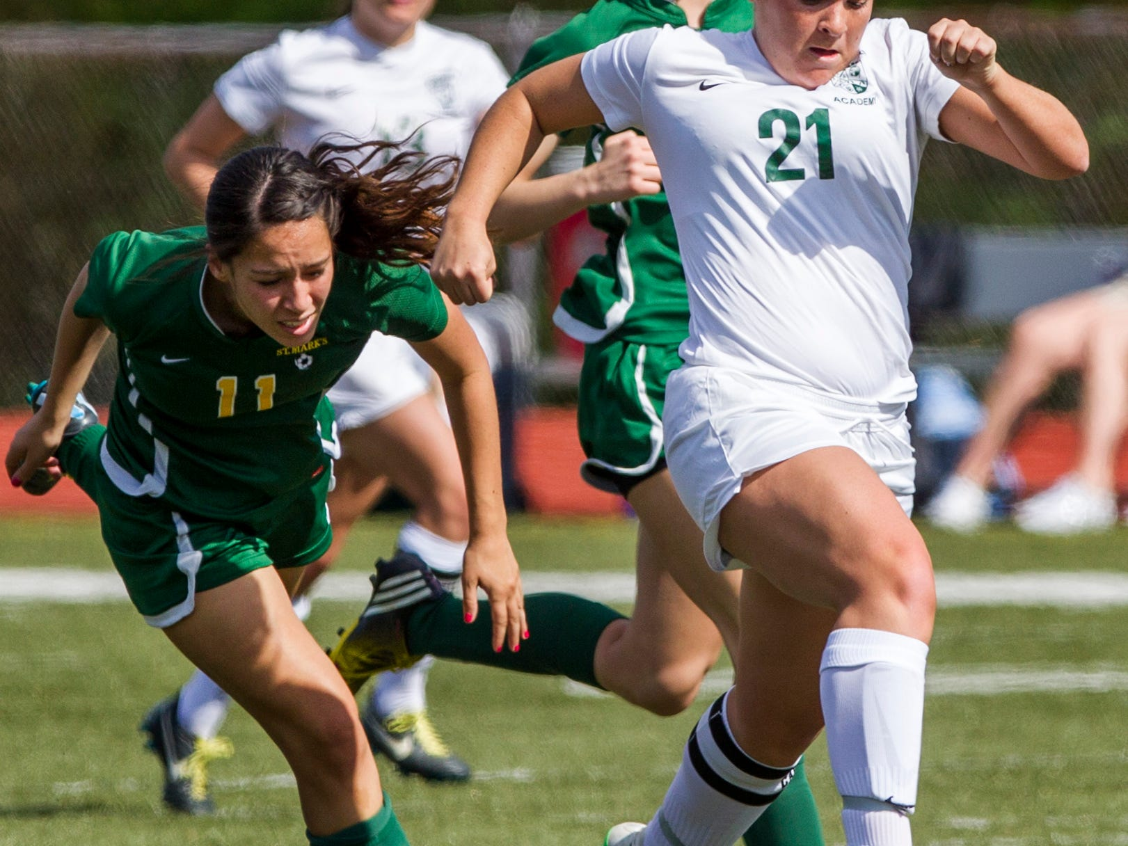 Archmere's Gillian Sweeney breaks away from St. Mark's Rachel McCabe during a game at Archmere Wednesday afternoon. Archmere defeated St. Mark's 2-1.