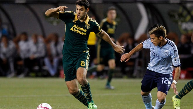 Portland Timbers midfielder Diego Valeri, left, controls ball against Sporting KC midfielder Mikey Lopez, right, during the first half of an MLS soccer match in Portland, Ore., Saturday, Oct. 3, 2015.