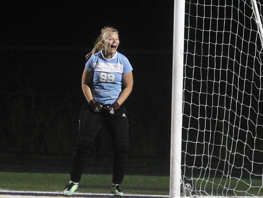 Mariah Frommeyer celebrates her second save of the
