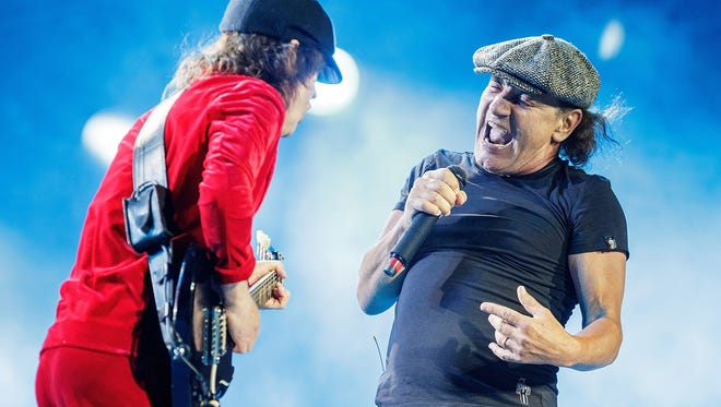 Sarasota resident Brian Johnson, right, seen here performing in 2015 at Etihad Stadium in Melbourne, Australia, during AC/DC's Rock Or Bust World Tour, has reunited with AC/DC for the new 'PWRUP' project announced this week.