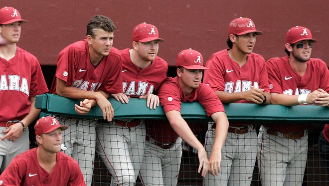 Players in the Alabama dugout watch their last out against Kennesaw State in an NCAA baseball regional game on Monday  in Tallahassee, Fla. Kennesaw State won the rubber match over Alabama 4-2 to move on to the super regional expected to be in Louisville.
