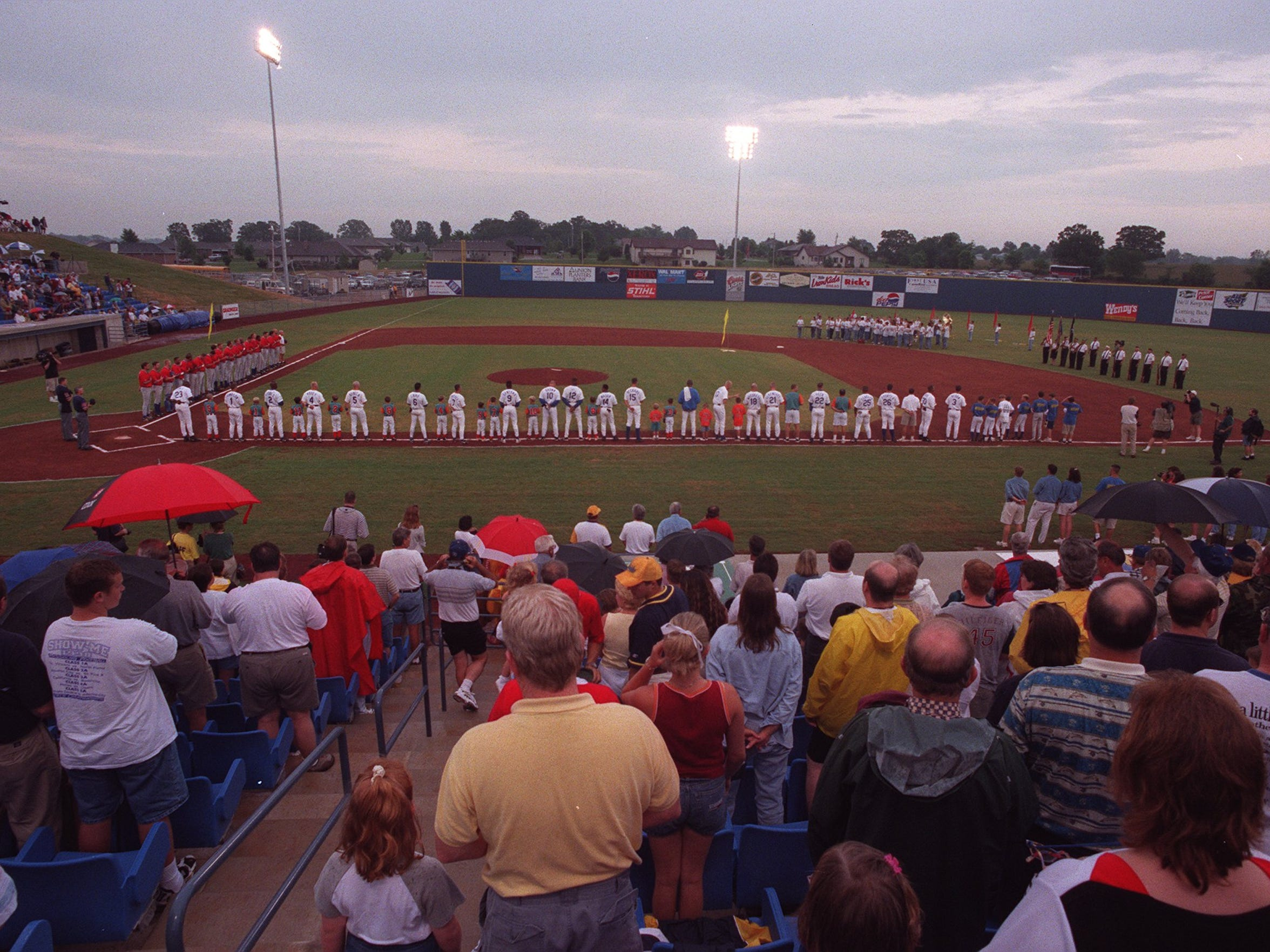 For the first time in more than 50 years minor league baseball returned to the Ozarks as the crowd at the Ozark Mountain Ducks stadium in Ozark, MO., stand for the National Anthem in 1999.