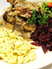 Wild Pork Shanks are available as an appetizer or entree (shown) at OB's Brau Haus.