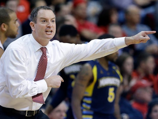 Rutgers coach Mike Rice shouts to his players during
