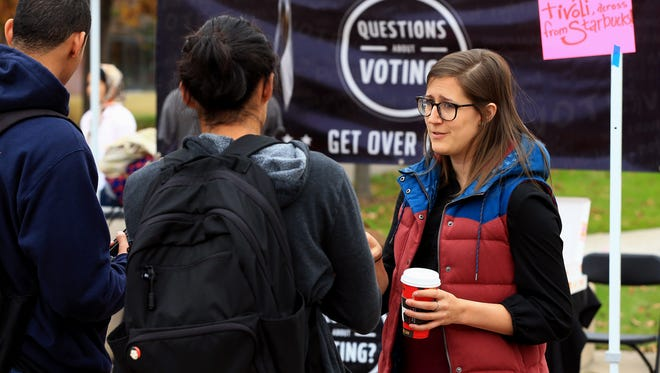 Lizzy Stephan from New Era Colorado talks to students about candidates and voting on Oct. 25, 2016, at the University of Colorado-Denver in Denver, Colorado. There are lots of efforts in the state to get registered voters to return their mail ballots or vote on Election Day.
