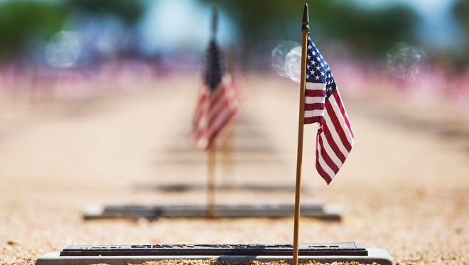 Flags mark every grave at the National Memorial Cemetery of Arizona.