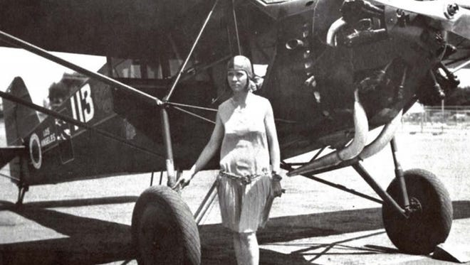 Vera Dawn Walker and the Curtiss Robin, which she flew in the first National Women's Air Derby in 1929.