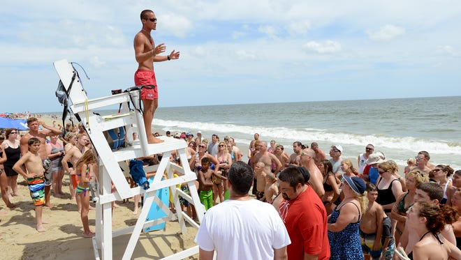 In this file photo, Ocean City Beach Patrol Crew Chief Tom Lurie holds a water safety session with beachgoers near 28th Street in Ocean City.
