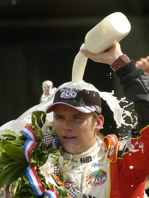 Dan Wheldon of Team Andretti Green Racing pours milk over his head after winning the 89th Indianapolis 500.
