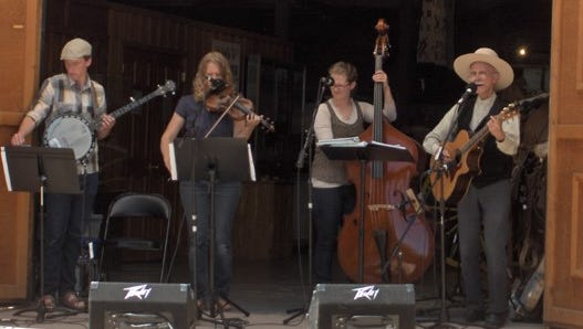 Folk music fills the air at the Folklife Festival at Frontier Homestead State Park Museum.