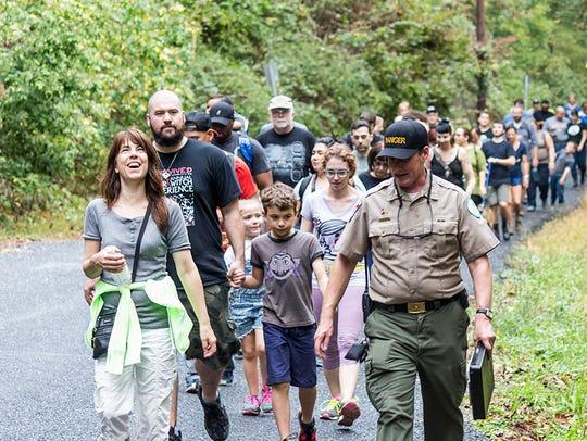 Park Ranger Erik Ledbetter leads a group of people
