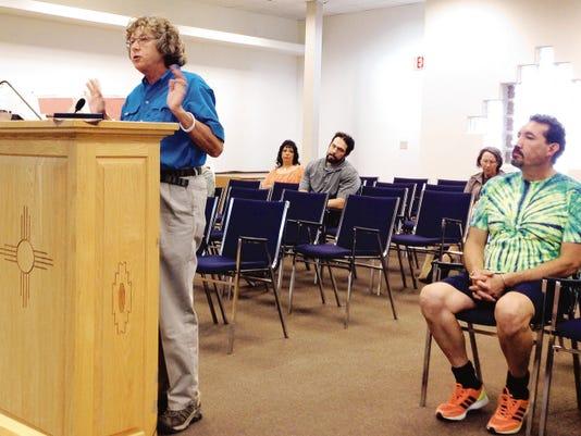Resident Cissy McAndrew, left, discusses speeding traffic on Bullard Street at Tuesday's Silver City Town Council meeting. Randal Seyler-Sun-News