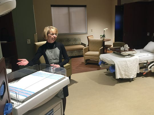 Chief Nursing Officer Lisa Gann shows an isollette