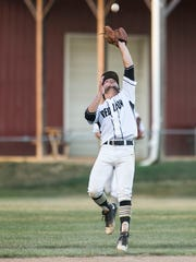 Red Lion's Alex Zelger catches a pop fly during a