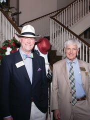 """Jerry the Horse"" peeps in as Derby Party guests are greeted by Hospice of Montgomery Board president Lee Sims, left, and Arthur Mazyck (Courtesy of Patricia White Photography)"
