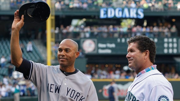 Former Yankees Mariano Rivera acknowledges the crowd after receiving a gift from former Mariners great Edgar Martinez on behalf of the Seattle Mariners prior to the game at Safeco Field on June 6, 2013.