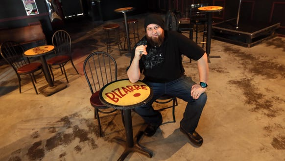 Mojo 13 co-owner Matthew Jester sitting at a table