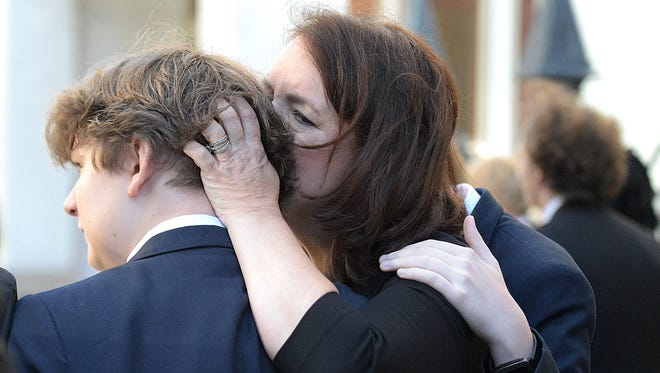 Family members of Sen. Douglas Henry comfort one another during his funeral service at the Downtown Presbyterian Church in Nashville on Friday, March 10, 2017.