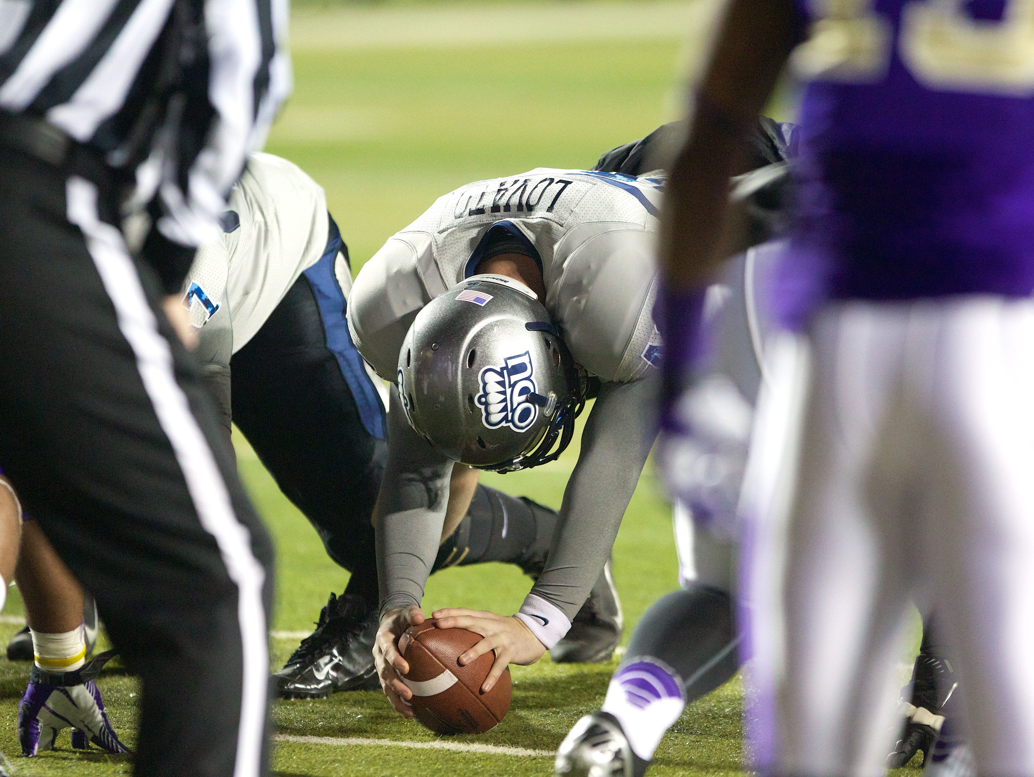 Former Middletown South standout Rick Lovato Jr., shown snapping the ball at Old Dominion, hopes to become the fifth Eagles' player to make it to the NFL.