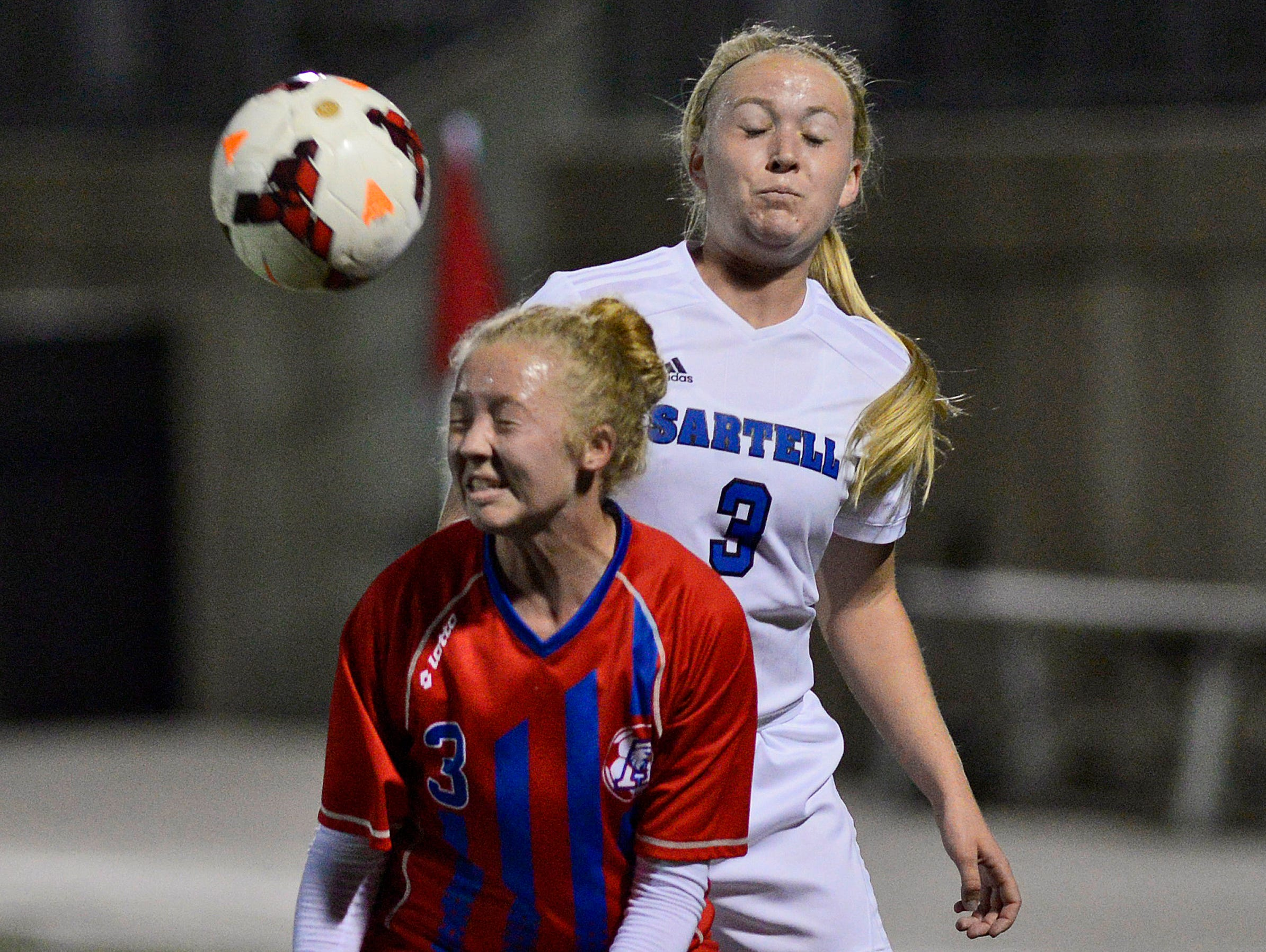 St. Cloud Apollo's Claire Sautner, left, heads the ball away from Sartell's Bria Ferns (3, right) in the first half of their Sect. 8A championship game Thursday, Oct. 22 at Husky Stadium.