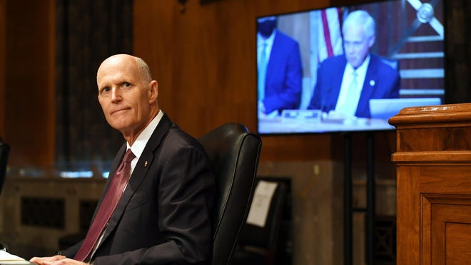 Sen. Rick Scott, R-Fla., listens listens during a Senate Homeland Security and Governmental Affairs Committee hearing to examine Department of Homeland Security personnel deployments to recent protests on Thursday, Aug. 6, 2020, in Washington.