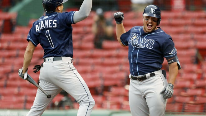 Tampa Bay Rays' Hunter Renfroe celebrates his solo home run with Willy Adames (1) during the sixth inning of a baseball game against the Boston Red Sox, Thursday, Aug. 13, 2020, in Boston.