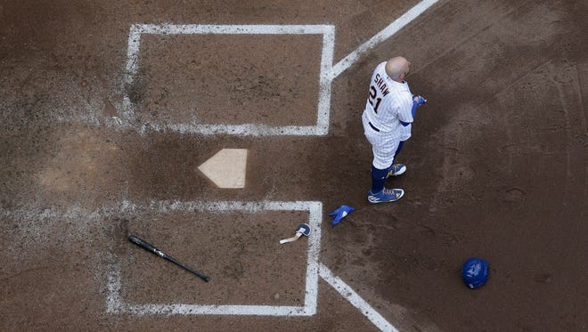 Travis Shaw walks away after striking out against Phillies right-hander Zach Elfin during the fourth inning Saturday at Miller Park.