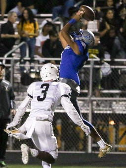 Sayreville's Cameron Davis (7) catches a pass under coverage by South Brunswick's Thomas Joe-Kamara (3) on Oct. 20, 2017.