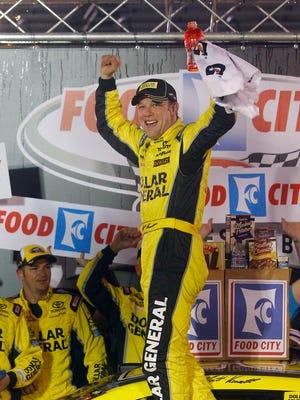 Matt Kenseth celebrates in victory lane after winning  at Bristol Motor Speedway on Sunday.