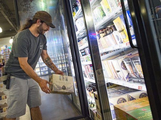 Dom Gambone selects a 12-pack of beer from Odell Brewing