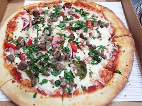 Pizzas are freshly made after 4 p.m. Mondays through Saturdays at Frankie's Italian Deli.