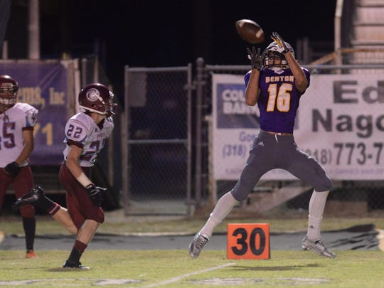 Benton's John Westmoreland pulls in the pass for a first down against Minden.