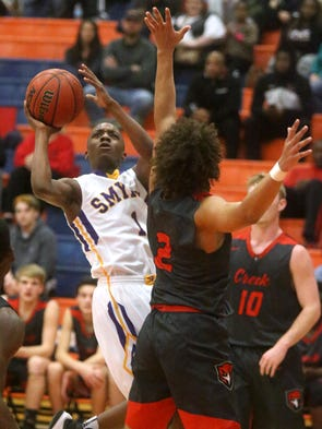 Smyrna's Tae Brady (1) goes up for a shot as Stewarts