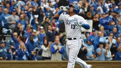 Salvador Perez points to the sky after hitting a solo