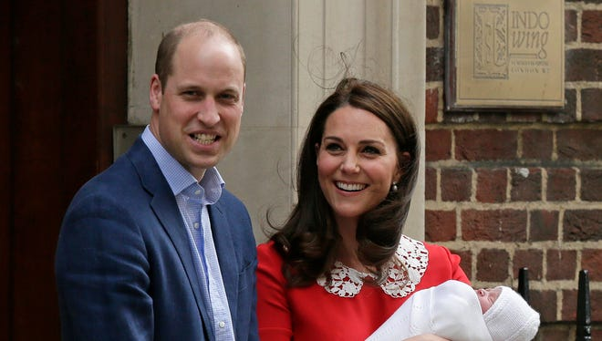 Britain's Prince William and Kate, Duchess of Cambridge smile as they hold their newborn baby son Louis.