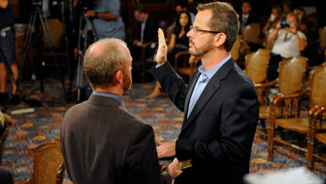 State Rep. Todd Courser  is sworn in before testifying before the House Select Committee alongside his attorneys at the Capitol Wednesday 9/9/2015.