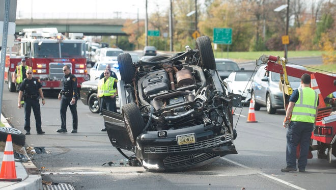A towing company works to upright a vehicle after it over turned on Rt. 38 East in Cherry Hill between Cuthbert Blvd. and Longwood Ave. Thursday, October 29, 2015.