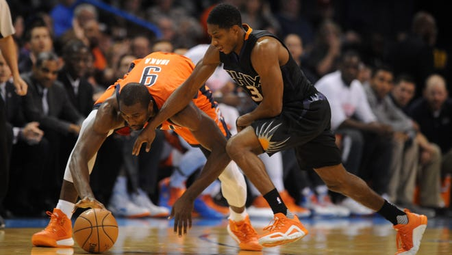 Oklahoma City Thunder forward Serge Ibaka (9) and Phoenix Suns guard Brandon Knight (3) dive for a loose ball during the fourth quarter at Chesapeake Energy Arena.
