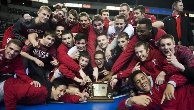 Delsea's wrestling team celebrates after winning the program's second state championship with a 28-27 victory over Paramus on Feb. 15, 2015.