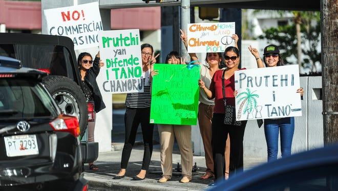 In this March 16, 2016, file photo, members of the University of Guam Social Work Student Alliance, Protehi i Tano, Nasion Chamoru and others, gather for a peace rally at the ITC intersection in Tamuning.