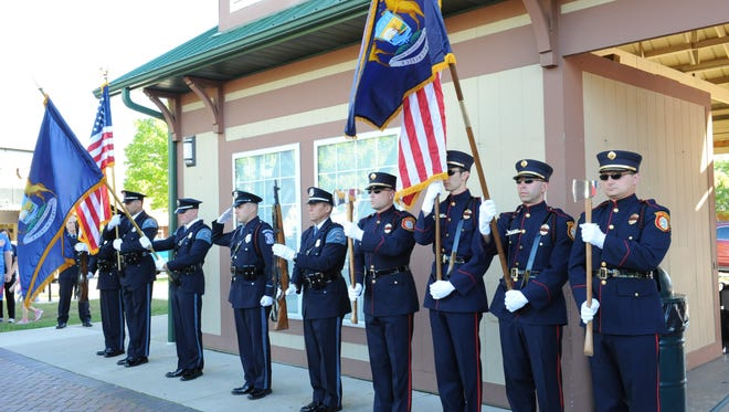 The Farmington, Farmington Hills Police and Fire Honor Guard stand at attention during the National Anthem at this years Patriot Day Ceremony held Sunday.