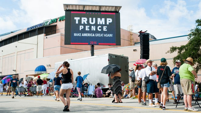 People wait in line outside of a Trump rally at Germain Arena in Estero on Monday, Sept. 19, 2016.